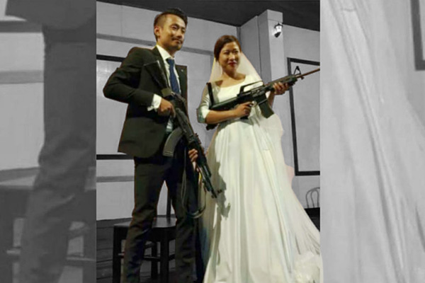 Naga couple arrested for posing guns in wedding pics